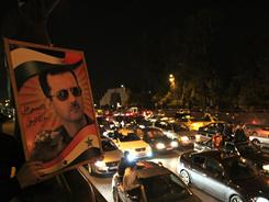 Supporters of Syrian President Bashar Assad demonstrate at Damascus' Old City landmark, Omayyed Square, on Friday.