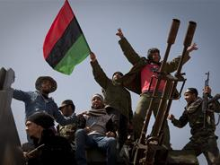 Libyan rebels celebrate Monday on the front line outside of Bin Jawaad. Coalition airstrikes have allowed rebels to advance toward Moammar Gadhafi's hometown of Sirte.
