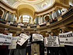 State workers protest Wisconsin Gov. Scott Walker's proposed limits on public employees' collective-bargaining powers Feb. 15 at the state Capitol.