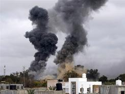 Smoke billows as explosions rock the LIbyan capital Tuesday as coalition bombing provides support for rebel forces.