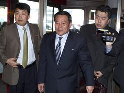 North Korean diplomat Ri Gun, center, arrives to give a statement at the Tegel airport in Berlin on Wednesday.