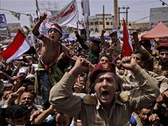 Yemeni army officers and anti-government protesters demand the resignation of Yemeni President Ali Abdullah Saleh in Sanaa.
