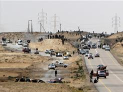 Libyan rebels engage in street battles with forces loyal to Moammar Gadhafi near the eastern town of Brega.