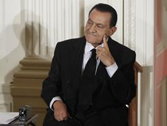 In this file photo, Hosni Mubarak listens as Israel's Prime Minister Benjamin Nethanyahu speaks in the East Room of the White House. 
