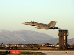 A Canadian Forces CF-188 Hornet jet fighter takes off from the Birgi NATO air base in Trapani, Italy.