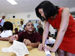 Michelle Rhee, then-D.C. public schools chancellor, talks to third-grader Kmone Feeling at J.O. Wilson Elementary School on Aug. 23.