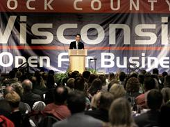 Wisconsin Gov. Scott Walker addresses the 2011 Forward Janesville banquet on Tuesday. A request for e-mails relating to the state's labor strife has triggered controversy.