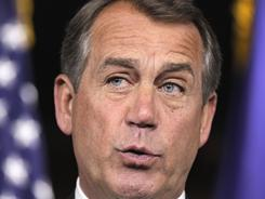 House Speaker John Boehner talks to reporters on Capitol Hill on Thursday about the budget impasse that threatens a government shutdown.