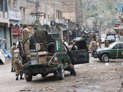 Pakistan army soldiers cordon off an area after a suicide bomb attack near Peshawar on Friday.