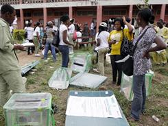 Officials check election materials Saturday at the distribution centre in Ibadan, Nigeria.