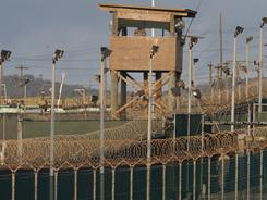 Camp Delta guard tower at the U.S. detention center in Guantanamo Bay. Military tribunals will try some 9/11 suspects, it was announced.