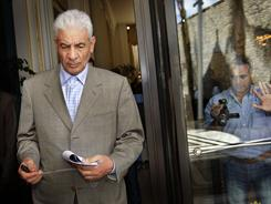 Libya's former foreign minister, Moussa Koussa, leaves after reading a statement to foreign journalists in Tripoli on March 18. He fled the country and is now in Britain.