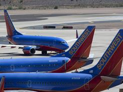 Officials discovered cracks in more Southwest jeltiners, and the airline company grounded flights Monday for inspections.