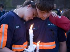 Friends, family, and community members participate in a candle light vigil at Marshfork Elementary School held for the deceased coal miners on April 10 in Montcoal, W.Va.