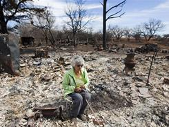 Rafaela Franco, 72, sits in what used to be a bedroom of her home last Thursday on Highway 208 in Colorado City, Texas.
