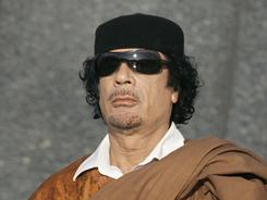 """You are a man who has enough courage to annul a wrong and mistaken action,"" Moammar Gadhafi says in a letter to President Obama."