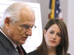 Rep. Bill Pascrell Jr., D-N.J., accompanied by Lauren Alfred, legislative assistant to Rep. Gabrielle Giffords, D-Ariz., speaks about treatment for traumatic brain injuries Thursday on Capitol Hill.