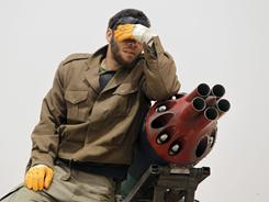 A Libyan rebel reacts to reports of an airstrike on rebel forces Thursday.