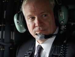 Defense Secretary Robert Gates flies on a Blackhawk helicopter back to Camp Victory after meeting with Iraq's president and prime minister Thursday.