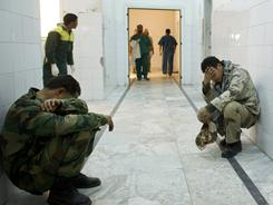 Libyan rebel fighters react after delivering wounded and killed comrades at a hospital in Ajdabiya on Thursday.