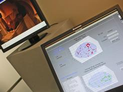 A computer monitor showing the NeuroSys project, a language-based, brain-computer interface, is displayed during an Intel Corp. open house in New York.