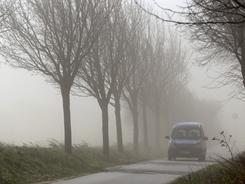 A motorist drives through a sand storm in the eastern German town of Fahrenholz on Friday.
