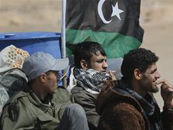Libyan rebels battle pro-Gadhafi troops for control of a key roadway in western Libya.