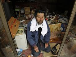Kunio Shiga, 75, was stranded alone in his farmhouse in Minami Soma, Fukushima Prefecture.