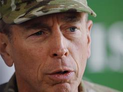 Army Gen. David Petraeus speaks with members of the media following a farewell ceremony for Ambassador Mark Sedwill, NATO's senior civilian representative Saturday in Kabul, Afghanistan.