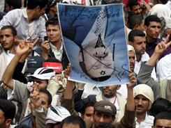 Yemeni anti-government protesters hold an upside-down picture of Yemeni President Ali Abdullah Saleh during a demonstration calling for his ouster in Sanaa on Friday.