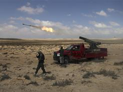 NATO airstrikes helped Libyan rebels drive Moammar Gadhafi's forces out of the hard-fought eastern city of Ajdabiya, the gateway to the opposition's stronghold.