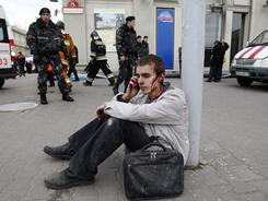 A wounded blast victim speaks on a cellphone at Oktyabrskaya subway station in Minsk, Belarus, on Monday.