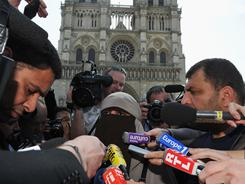 Kenza Drider addresses the media as she demonstrates against the ban of the full-face veil in public places on Monday in Paris.