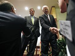 Senators Mark Warner, D-Va, left, and Saxby Chambliss, R-Ga, are urging action on the debt.