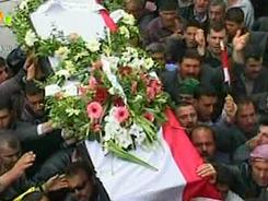 An image grab taken from footage broadcast by the Syrian state television shows Syrian mourners carrying a coffin during the funeral of two members of the security forces in Hama, north of Damascus, on Sunday.