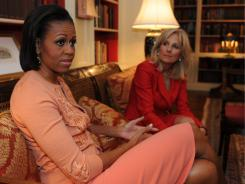 First lady Michelle Obama, left, and Jill Biden, wife of Vice President Biden, talk about their new initiative to help military families on Tuesday.