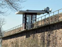 A guard house sits atop a wall of the South Dakota State Penitentiary, where a guard was shot and killed during a failed escape attempt on Tuesday in Sioux Falls, S.D.
