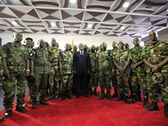 President Alassane Ouattara, center, poses with commanding officers from the republican forces at the Golf Hotel in Abidjan, Ivory Coast, on Tuesday.