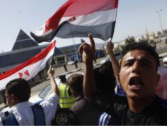 Protesters gather Wednesday in front of the hospital in the Red Sea resort of Sharm el-Sheikh where Egypt's former President Hosni Mubarak is being treated