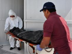 Forensic personnel unload bodies of people killed execution-style in Matamoros, Tamaulipas State, Mexico, on Monday.
