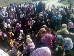 Syrian women and children hold an anti-government demonstration in Banias, demanding authorities release those detained during a crackdown on opponents of the regime, witnesses said.