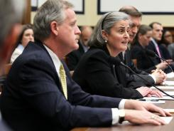 Patrick Hallinan, left, superintendent of Arlington National Cemetery, and Kathryn Condon, executive director of the Army National Cemeteries Program in the Office of the Secretary of the Army, testify Thursday on Capitol Hill.