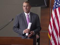 House Speaker John Boehner of Ohio arrives for a news conference on Capitol Hilll on Thursday.