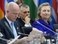 Secretary of State Hillary Clinton sits alongside Britain's Foreign Secretary William Hague, left, during a NATO meeting on Libya in Berlin on Thursday.