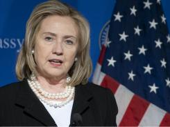 Secretary of State Hillary Rodham Clinton warned Friday that rising intolerance toward women and religious minorities threatens to derail democratic transitions around the Arab world.