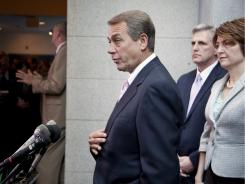 House Speaker John Boehner of Ohio gestures during a news conference Friday on Capitol Hill.