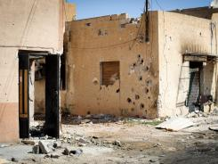 Gadhafi forces open fire Friday on houses in the western town of Misrata, Libya.