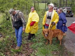 Volunteers search along rural roads and woods  for evidence in the disappearance of Holly Bobo on Friday.