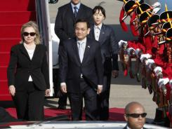 Secretary of State Hillary Rodham Clinton inspects honor guards with South Korean government official Ahn Young-jip upon her arrival at Seoul military airport in Seongnam, South Korea on Saturday.