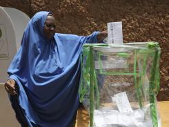 A woman cast her vote at a polling place Saturday in Daura, Nigeria.